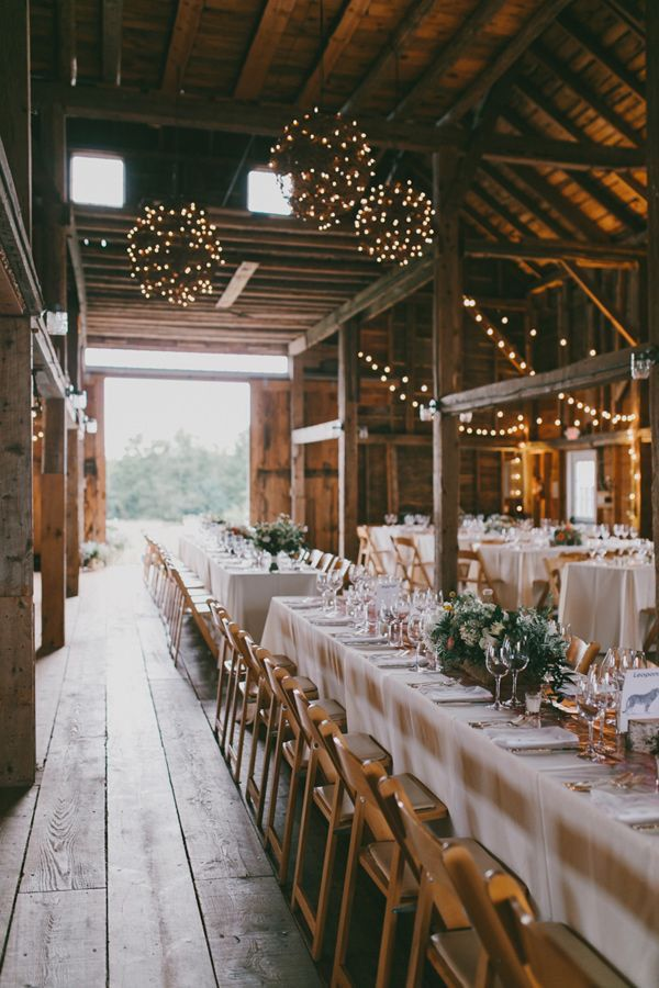 Elegant table for wedding reception in barn