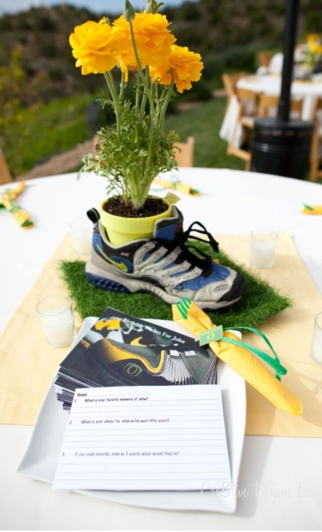Flower pot in old running shoe for a graduation party