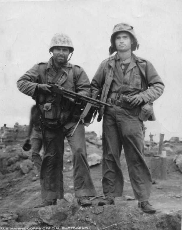 Marines Duncan and Perry, 4th Marine Division, after ten days of fighting on Iwo Jima. Note Duncan carrying the BAR (Browning Automatic Rifle) squad automatic weapon back then, and Perry presenting the M1A carbine.