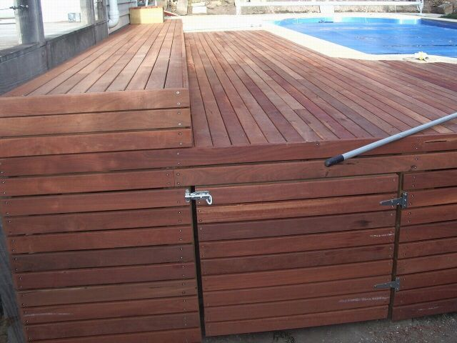 Spotted gum deck with underneath storage area. Designed and installed by HOLLANDSCAPES.