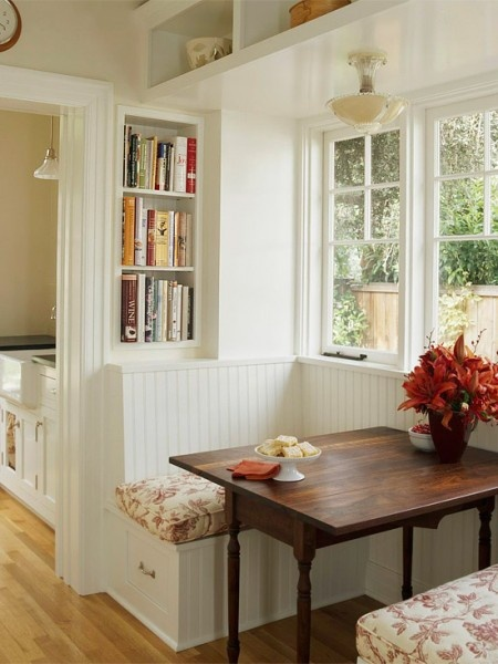 Kitchen Nook. Love how the table contrasts. (I agree) Also, like the window, the above shelf across the window and room for books in the wall nook