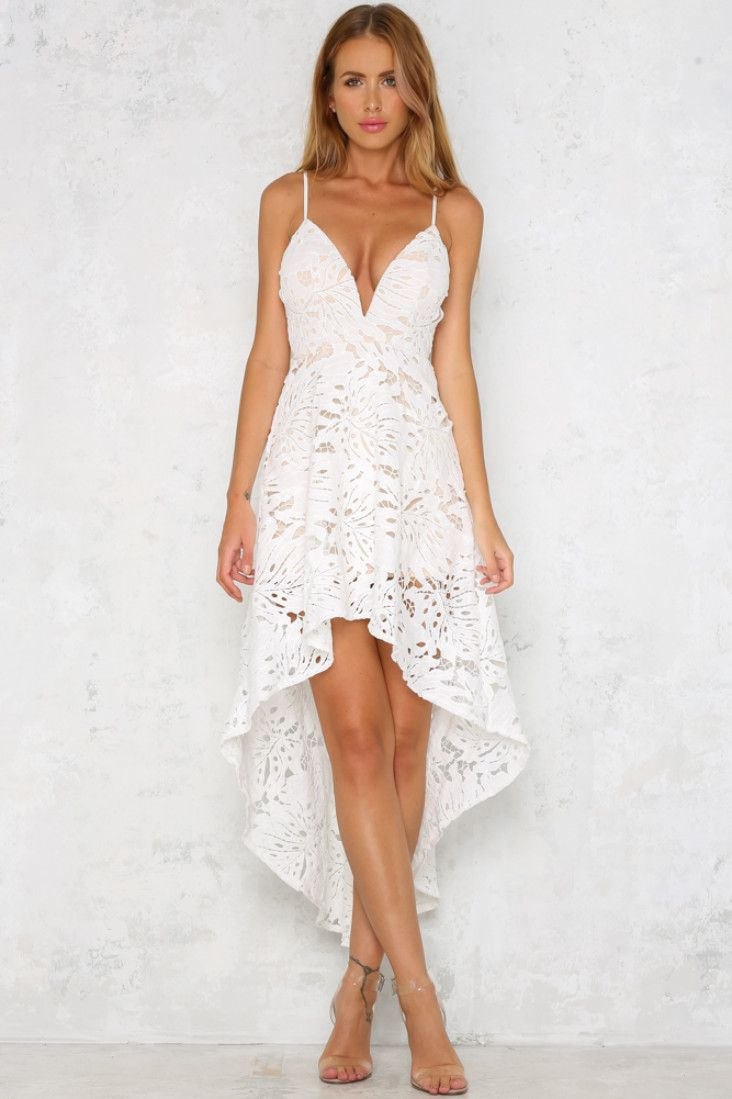 The Sunset Dance Maxi Dress is sleeveless, with thin spaghetti straps, a padded bust and a plunging necklace. We love the exquisite lace detailing and hi-low hem! Wear with nude heels and delicate gold jewellery!  White maxi dress. Half lined. Cold hand wash only. Model is a standard XS and is wearing XS. True to size. Non stretchy fabric. Polyester.