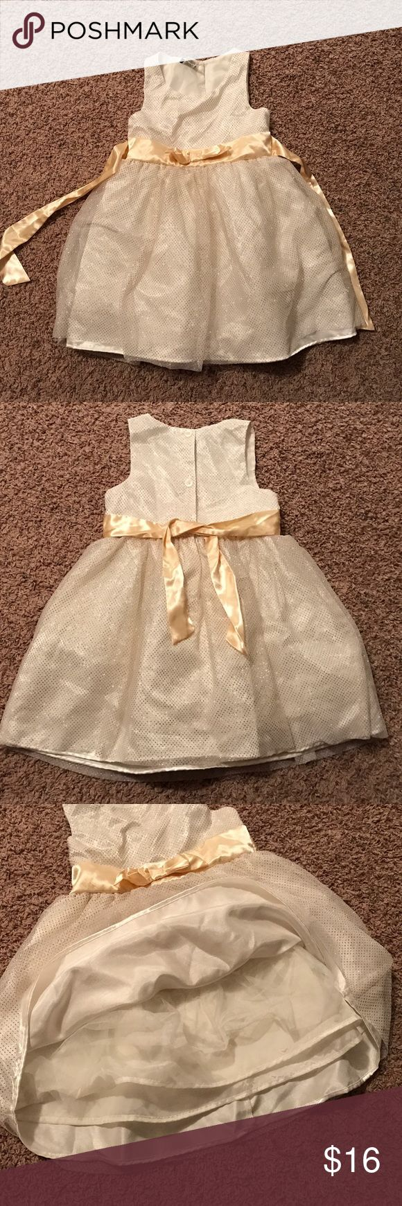 Holiday Editions Cream and Gold Sleeveless Dress Beautiful, new without tags. This dress is gorgeous in person. So sparkly with the perfect shade of gold. It's lined and has crinoline. Buttons in back. Gold satin tie back. Girls small/6x. ❤️ offers accepted and bundle discounts ❤️ holiday editions Dresses Formal