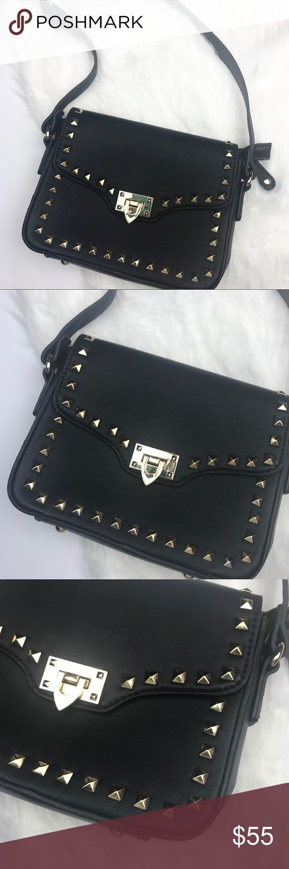 Black Vegan Leather Rockstud Crossbody Bag Good preowned condition • Used one time • Black vegan leather rockstud cross-body bag • Gold pyramid studs • Circular gold feet • Super trendy • Perfect for essentials • Adjustable cross-body strap, works for tall girls too • Very minor wear from storage • Ask all questions before purchasing! • Length: 7 inches • Width (across): 9 inches *** (#176). Bags Crossbody Bags