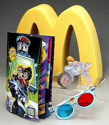 The McDonald's Spy Kids 3-D Happy Meal promotion ran from July 25, 2003 – August 14, 2003 at participating McDonald's restaurants nationwide. Offering non-stop, page-turning adventures featuring the popular characters Juni and Carmen, six different premiums included a 12-page 3-D Spy Kids comic book, a pair of 3-D glasses and an action figures. The 3-D comic books tell a short story inspired by the Spy Kids 3-D movie script, complete with cliffhanger excitement for the reader.