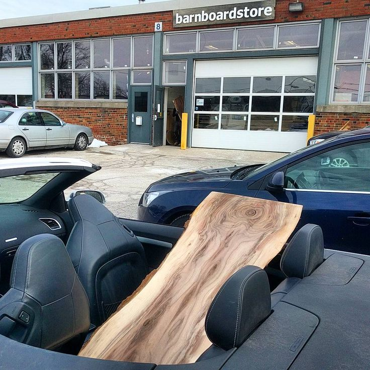 Our customers are as passionate about wood as we are!  In this picture a great repeat client wanted a cool live edge walnut slab to make a coffee table.  It was a little too big to fit in the trunk.........Sooo - down goes the convertible top for a short but slightly chilly ride home (it is a nice sunny day but it is 0 degrees Celsius)  Nothing stops our clients from getting what they need at Barnboardstore.com  #convertible #gitrdone #barnboard #barnwood #barn #reclaimed #reclaimedwood…