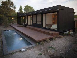 small shipping container home and pool. Planning approval/law/crane/access/Plot/Footings/Power:solar plumbing/Water Tanks/shed for solar power to Batteries.Add strength frame around Window openings/door windows/switches/sink taps More