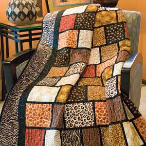 Into Africa: Quick Fat Quarter-Friendly Novelty Lap Quilt Pattern  Designed by COLLEEN REALE & CHLOE ANDERSON for TOADUSEW Made by MARTHA PULLUM Machine Quilted by ASTA DORSETT, patterned in America Makes Fast Quilts, Spring 2013.