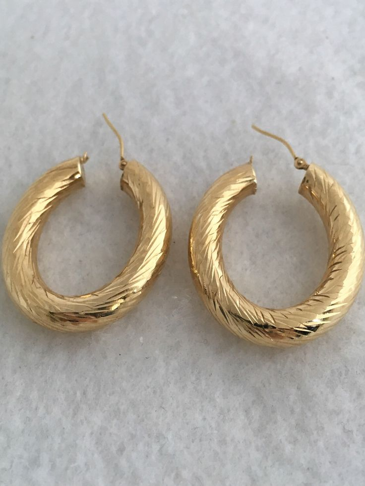 A personal favorite from my Etsy shop https://www.etsy.com/listing/497737992/14k-fine-gold-hoop-large-oval-ribbed