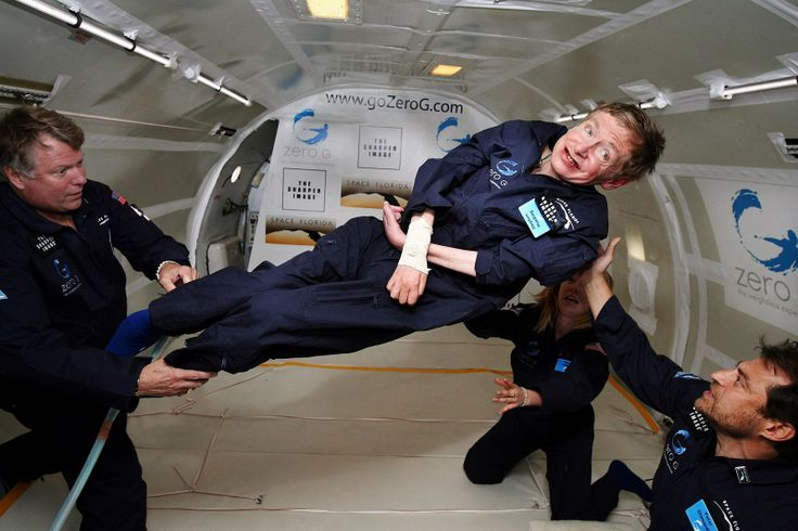 Stephen Hawking enjoys zero gravity during a flight aboard a modified Boeing 727 aircraft owned by Zero Gravity Corp. Hawking, Lou Gehrig's disease is being rotated in air by Mr Diamandis, founder of the Zero G Corp., and Mr Lichtenberg, former shuttle specialist & president of Zero. Kneeling below Hawking is Ms O'Brien, a nurse Pract. for Hawking's aide. Hawking announced his plans for a zero-gravity flight to prepare for a sub-orbital space flight in 2009 on Virgin Galactic's space…