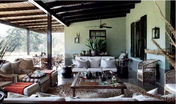 Kathy Waddell's house near Plett, via South of the Sahara: deep verandah, Malawi chairs