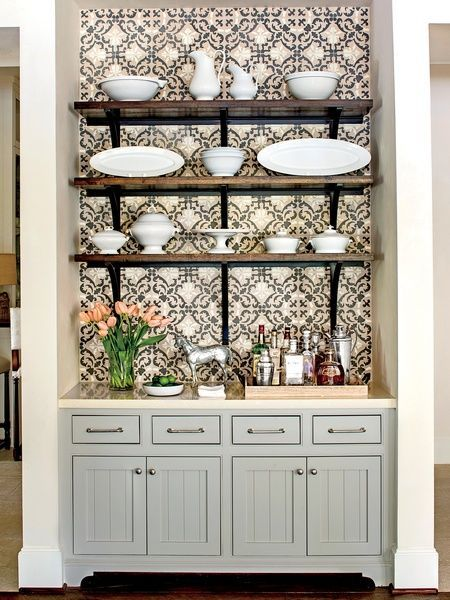 Add a patterned paper behind floating shelves or above your bar for a pop of color!