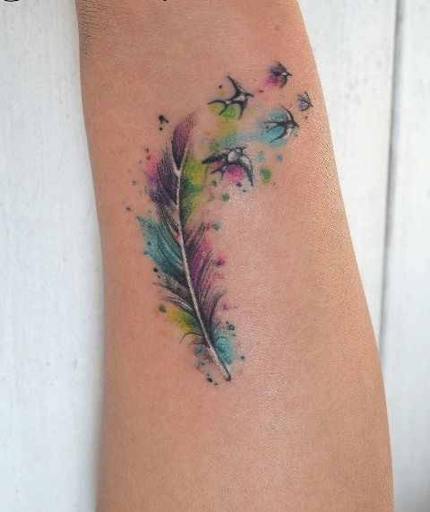 This color feather tattoo, with birds & an arrow.