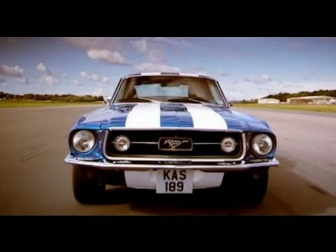 Top Gear's Jeremy Clarkson and the Stig take the 1967 Ford Bullitt Mustang and the 2007 Ford Mustang GT500 around the Top Gear test track.