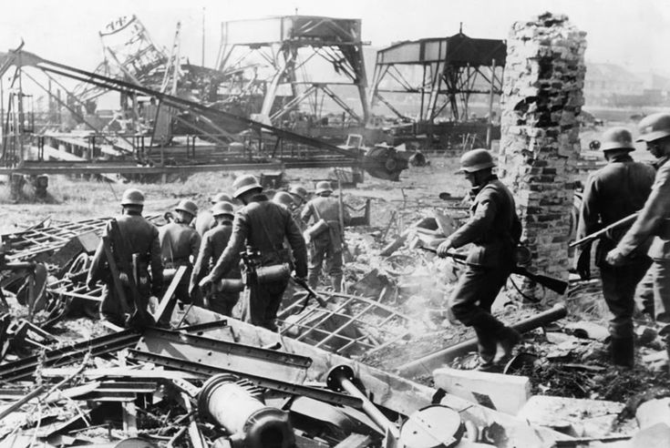 German soldiers comb the Westerplatte after it was surrendered to German units from the Schleswig-Holstein landing crew, on September 7, 1939. Fewer than 200 Polish soldiers defended the small peninsula, holding off the Germans for seven days.