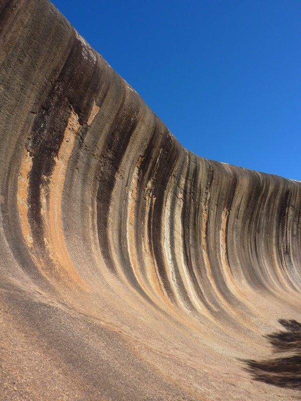 The Wave on Hyden Rock is one of Australia's most famous landforms, a giant surf wave of multicoloured granite about to crash onto the bush below. 350 kilometres east of Perth, Western Australia.