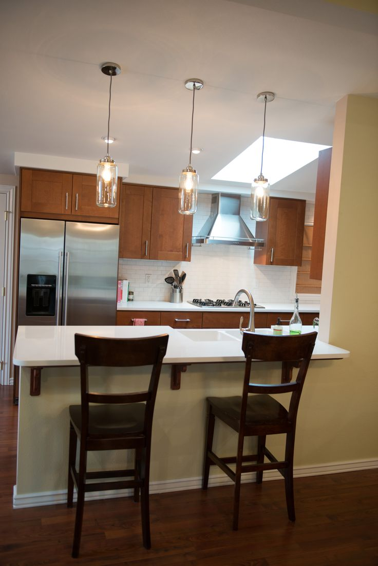 Medium Brown Kitchen Cabinets Glass Pendant Lighting Above White Quartz Counter Top And Ikea