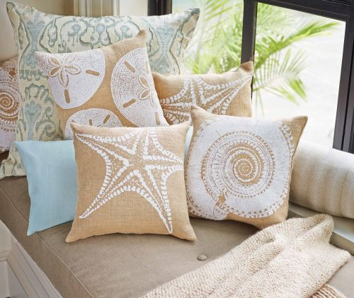 Seashell Pillow. Sand Dollar, Starfish or Nautilus Shell design forms a natural and textural pillow. Using white block print atop sand hued burlap creates a rustic, seaside style.