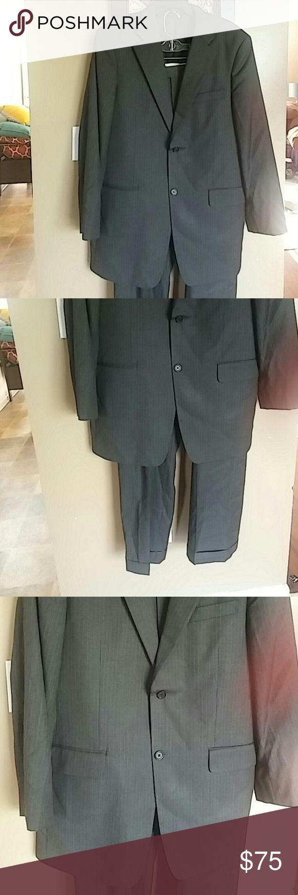 Executive Style John W. Nordstrom Suit This listing is for a Gray hue with faint vertical stripe john w. Nordstrom suit. Suit Tags reflect 42L/W36 but my measurements are as follows: Pants 41.5 in. Length, 18 in. Waist & The Jacket is 24.7 in. in the sleeve, 35 in. shoulder to hem and armpit to armpit is 20.5 in.. John W. Nordstrom Suits & Blazers
