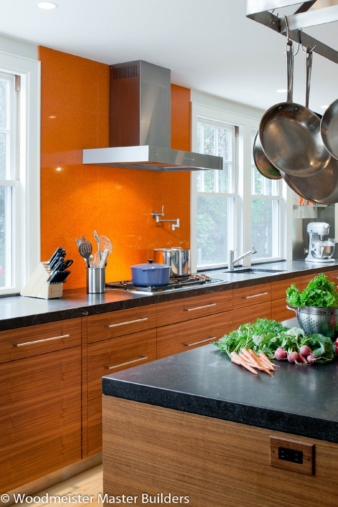 Love the orange accent wall kitchens pinterest