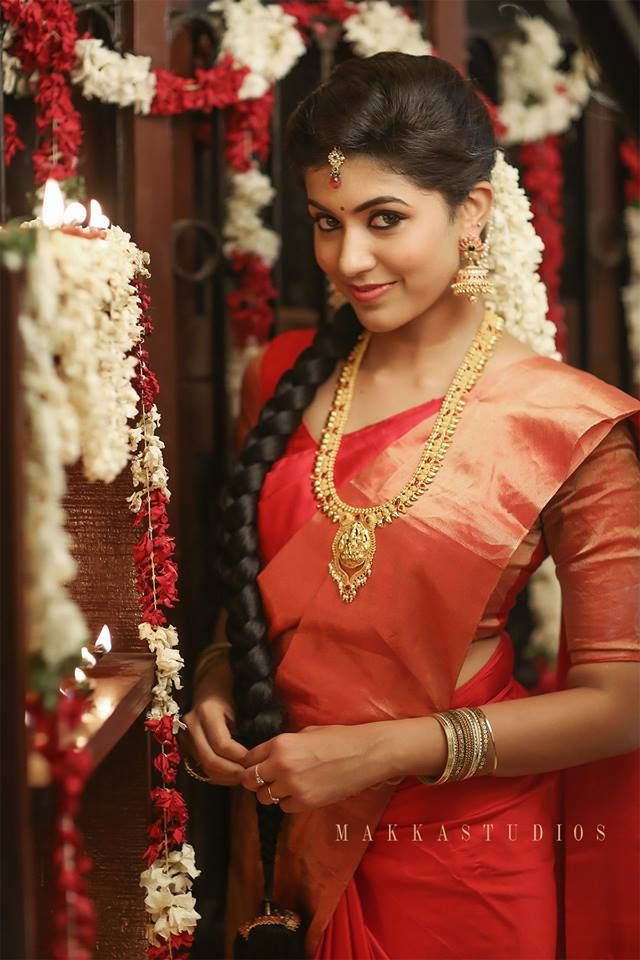South Indian bride. Temple jewelry. Jhumkis.Red silk kanchipuram sari.Braid with fresh jasmine flowers. Tamil bride. Telugu bride. Kannada bride. Hindu bride. Malayalee bride.Kerala bride.South Indian wedding.