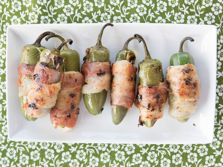 Marcela's Grilled Stuffed Jalapeno Chiles : Marcela removes the seeds from the jalapenos before stuffing them with mozzarella and wrapping them in bacon. Cooking them on the grill sizzles the outside, while the inside becomes oozy and creamy.