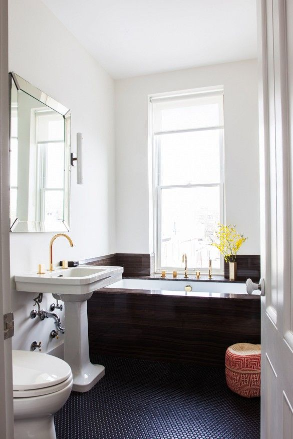 Black and white bathroom with brass