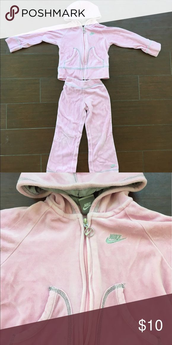 NIKE Sweat Suit Soft sweat suit with zip down hoodie that includes pockets and pants with an elastic waistband.  Silvery gray stitch trim along both pieces.  Like new condition. (SA) Nike Matching Sets