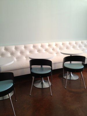 White Bench Seating, Cafe Tables, Dark Modern Chairs