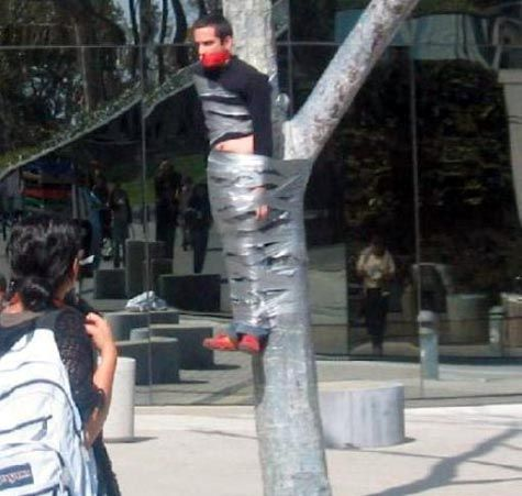 Stag do duct tape prank. Members of the public walking past witout lifting an eyebrow
