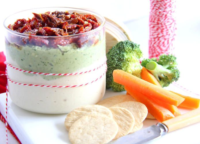 Get the Christmas party started with this very festive Cashew Cream Cheese and Pesto Dip!