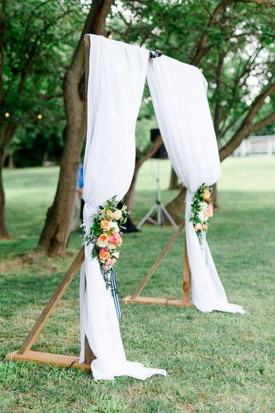 chic wedding ceremony altar with draped white linens and colorful rose flower arrangements / http://www.himisspuff.com/wedding-arches-wedding-canopies/3/