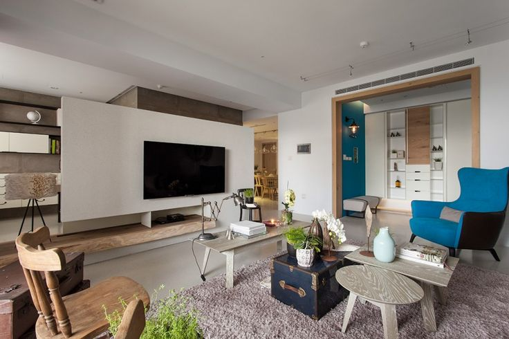 [Apartments] : Awesome Design Idea For Creative Living Room With Fancy Appliances And Creative Design Interior With Wooden Themed Completed With Some Wooden Table And Chair Pink Rug Also Modern Cabinet Plus Blue Foam Sofa