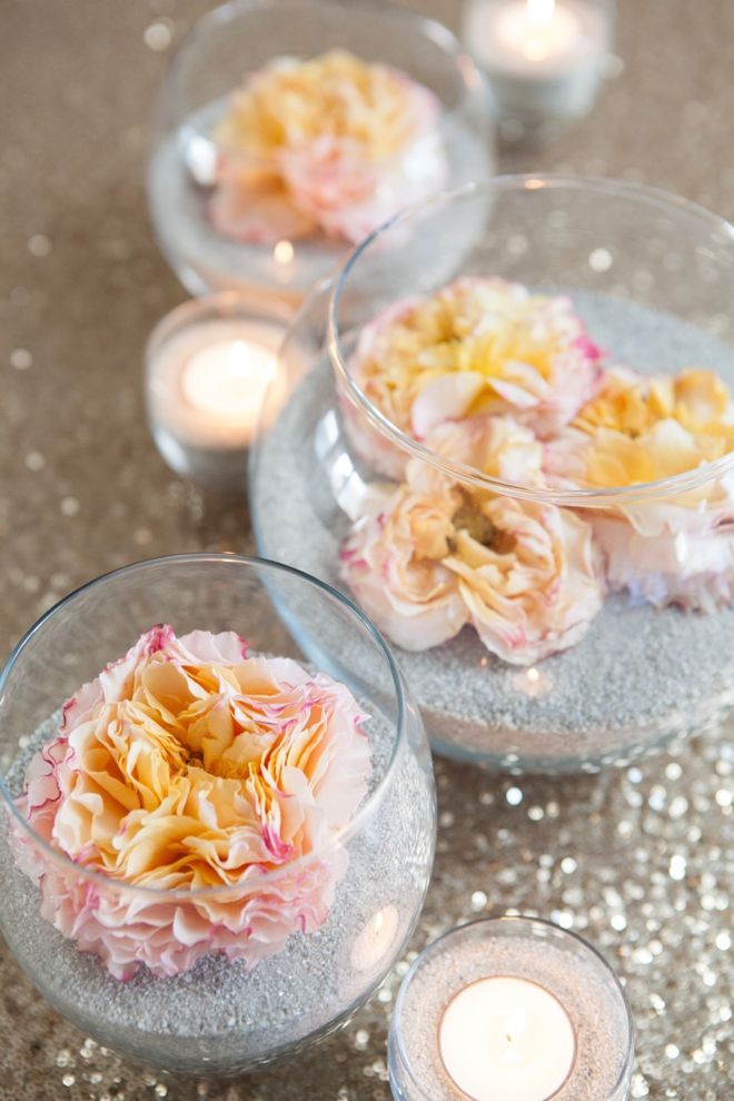 DIY flower and sand centerpieces. With some LED candles, this would be perfect! [reception]
