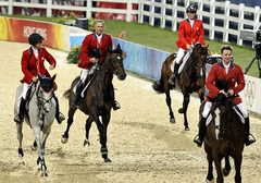 From left, US gold medallists Laura Kraut, Will Simpson, Beezie Madden and McLain Ward celebrate after winning the equestrian team show Jumping competition during the Beijing 2008 Olympics today in Hong Kong