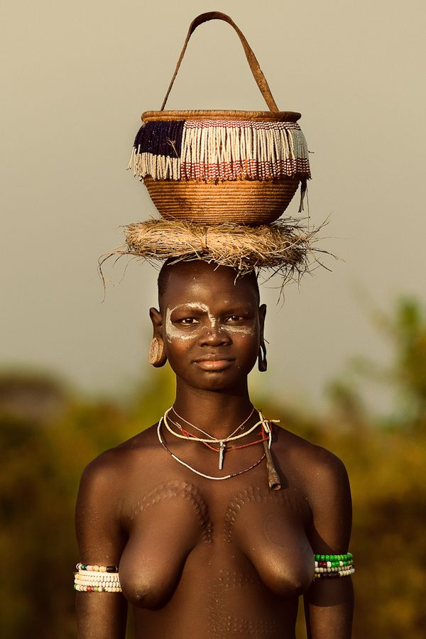 No designer labels, nor magazine makeup. beauty of culture, color, courage...because she is a woman. Don't you ignore her crown!