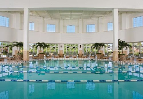 This daily fee includes: in-room high-speed Internet access, local calls up to 20 minutes, toll-free calls up to 20 minutes, access to the new fitness center, Relache, daily newspaper delivery (USA Today M-F/Tennessean Sat-Sun), in-room bottled water (two bottles provided, refreshed daily), and scheduled complex shuttle transportation.