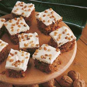 Carrot Cake Recipe -This wonderful recipe dates back to my great-grandmother! You'll love the texture this pretty, moist cake gets from pineapple, coconut and, of course, carrots! Its traditional cream cheese frosting adds just the right touch of sweetness.                             —Debbie Jones, California, Maryland
