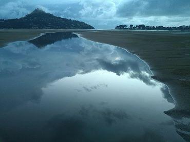 Reflections on Ocean Beach, looking towards Paku
