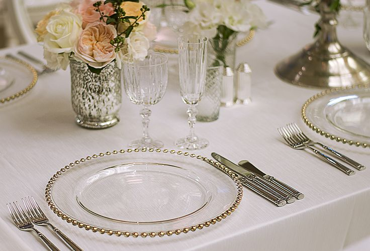 Place setting - Glass charger, candelabras, metallics accents, soft pinks