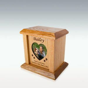 Small Heart & Oval Photo Pet Cremation Urn is created from solid red oak. Choose between a heart or oval picture frame. Optional choices of poems