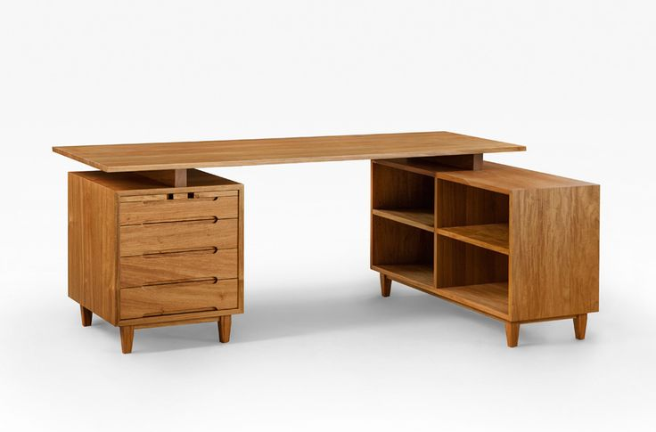 Mid century desk with floating top & bookcase return in solid Rosewood.  Enhancements include cable management shelves, concealed slide & touch to open drawers.