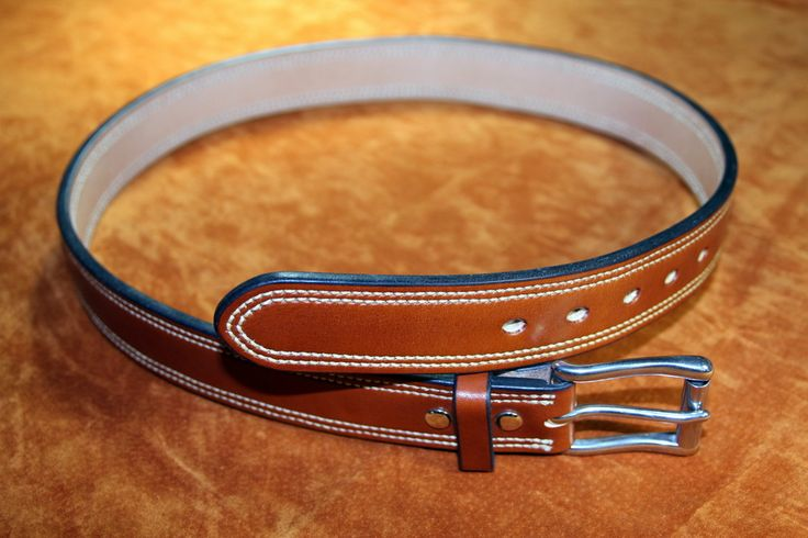 "Heavy duty full grain leather gun belt, ideal for concealed carry, built from two layers of vegetable tanned leather measuring approximately 1/4"" thick."