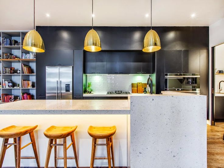 black, stone and brass kitchen - Michael and Carlene's Block Apartment