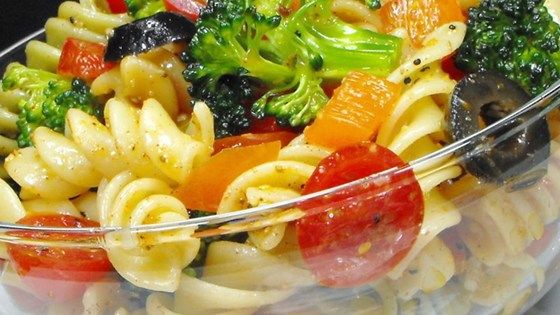 The veggies match the colors in the tri-colored pasta. And the dressing is real zesty and spicy. So when all three  - pasta, veggies and dressing - come together, you have a festive, tasty and beautiful salad for six.
