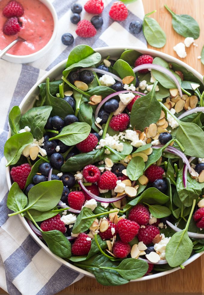 Power salad loaded with sweet berries, baby spinach, sliced almonds, and crumbles of feta. Then tossed with homemade sweet and tangy raspberry vinaigrette!
