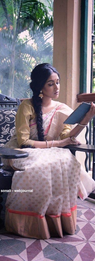 Handwoven Chander saree - Coloroso.in What a beautiful idea to get the model to read Dakshinaranjan Mitra Majumdar's Thakurmar Jhuli, the original hardbound collection of Bengali Fairytales :)