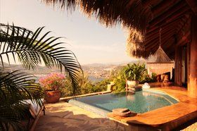 Amuleto - About 150 miles northwest of popular spring break spot Acapulco (and near lesser-known Ixtapa) is the Pacific Coast town of Zihuatanejo. Located just up the hill, Amuleto enjoys incredible views of the bay below (and a highly impressive sunset). Suites are spacious and some even include their own private terrace with plunge pools and hammocks. In other words, you can certainly make the quick trip down to the beach, but then again, you might not ever want to leave your luxe little…