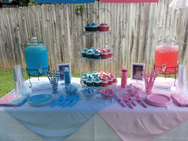 "BALL GAMES VS BALL GOWNS GENDER REVEAL PARTY. On one side I had blue receiving blanket and on the other pink, then blue raspberry lemonade, pink lemonade, pics of the dad and mom as babies, blue and pink kisses and bubble gum, blue and pink cupcakes with blue soccer ball and pink dress mints I made on top. Then I had two baby bottles filled with blue and pink ""babies"" (jelly beans), They each had the same number in them, and the two who guessed the closest number took them home. DON'T MISS…"