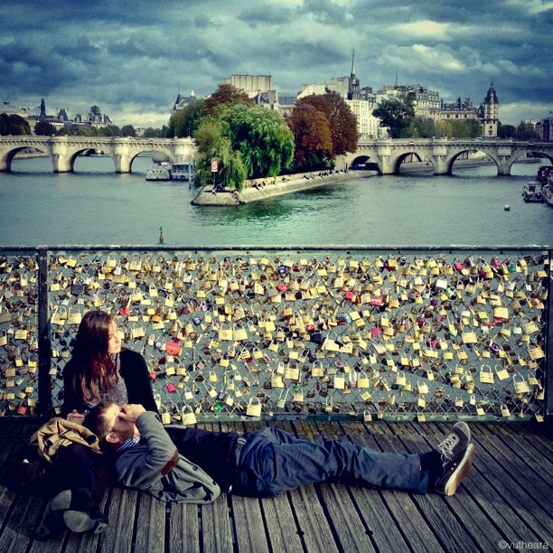 Bridge of love in Paris.........you take a lock and key and lock it to the fence with your loved one and you throw the key off the bridge!!  Awwwwwwww so romantical!!
